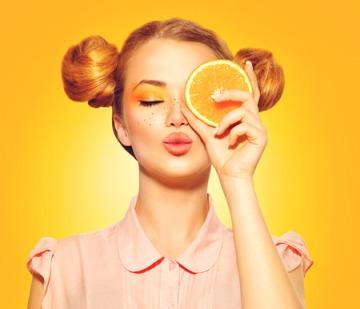54898654 - beauty model girl takes juicy oranges